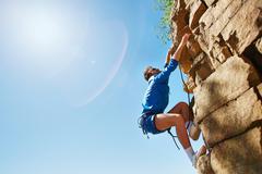 Climbing cliff Stock Photos