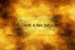 Claim tax refund grunge concept Stock Photos