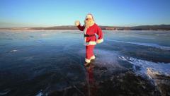 Santa Claus walking on the frozen ice of Lake Baikal - stock footage