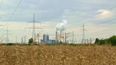 Coal powered electrical generation plant shot from distance Stock Footage