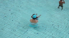 Shenzhen, China: people swimming in the swimming pool Stock Footage