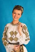 romanian folklore clothes traditional on blue azzure background - stock photo