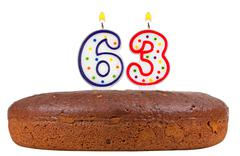 Birthday cake with candles number sixty three Stock Photos