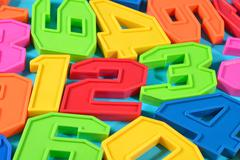 Colorful plastic numbers 123 on a blue background - stock photo