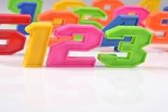 Colorful plastic numbers 123 on white - stock photo