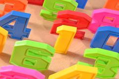 Colorful plastic numbers close up - stock photo