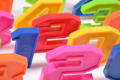 Colorful plastic numbers close up on a white - stock photo
