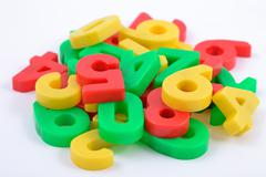 Colorful plastic numbers on white Stock Photos