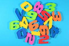 Colorful plastic numbers - stock photo