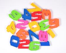 Colorful plastic numbers on a white Stock Photos