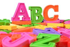 Plastic colored alphabet letters ABC on a white - stock photo