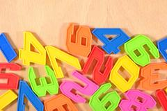 Plastic colored numbers Stock Photos