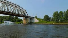 Motorboat pass under the railway bridge on the Moscow Canal. Stock Footage