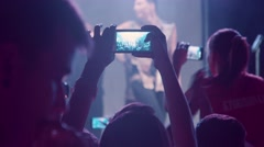 Guy shoots a concert on the phone - stock footage
