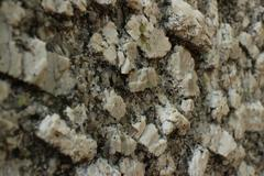 Close up perspective of Igneous Rock Surface Texture - stock photo