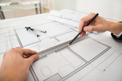 Close-up Of Engineer Drawing Diagrams With Pencil And Ruler On Blueprint Pape Stock Photos