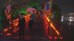 MS of people walking on the bridge, New Year in Ho Chi Minh City, North Vietnam Stock Footage