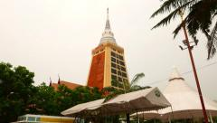 Tall stupa of Wat in Bangkok, long slide shot, camera move along road Stock Footage