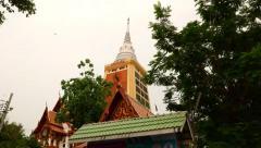 Tallest chedi pagoda in Bangkok at Wat Dhammongkol, slide low angle view Stock Footage