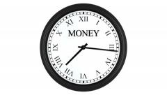 Time is money displayed on spinning clock with Roman numerals Stock Footage