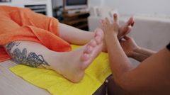 Reflexology foot massage Stock Footage