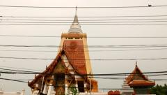 Tallest Wat Chaidei at Bangkok, slide shot, seen through wires Stock Footage