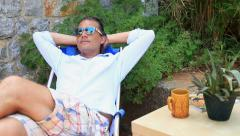 Man relaxing in the garden Stock Footage