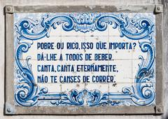 Panel of traditional Portuguese tiles hand-painted blue and white - stock photo