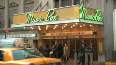 People on sidewalk in front of Broadway's Music Box Theatre [Broadway30] - stock footage