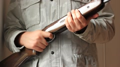 Soldier holding a rifle in his hands Stock Footage