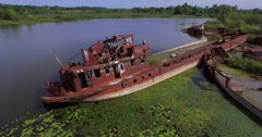 Stock Video Footage of Abandoned barges and boats on the river of Pripyat near Chernobyl town