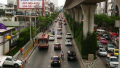 Slow traffic at Sukhumvit road near with Punnawithi BTS station, top view Stock Footage