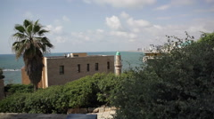 Mosque in Jaffa with Mediterranean sea and Tel-Aviv skyline in the background Stock Footage