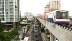 Overground metro train move away, elevated railway modern cityscape view - stock footage