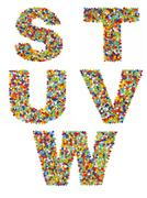 Letters of the alphabet S through W made from colorful glass beads on a white - stock photo