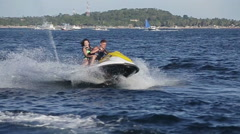 Happy couple riding jet ski. - stock footage