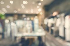 Defocused clothing boutique interior - stock photo