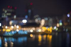 Blurred bokeh harbor lights at night Stock Photos