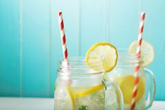 Lemonades in mason jars Stock Photos