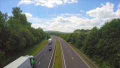 Wide Shot English Motorway Highway Road Cars Vehicles Traffic Clouds Hills Trees Stock Footage