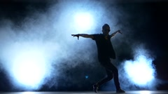 One hip hop break-dancer stylish man starts dancing, smoke, silhouette, slow Stock Footage