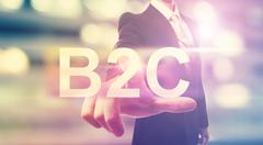Businessman pointing at B2C - stock illustration
