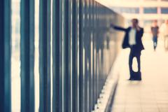 Blurred business man on the phone inside modern building Stock Photos