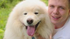 Young man hugging his dog - stock footage