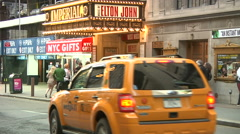 People gather in front of Imperial Theatre NYC for Elton John [Broadway33] Stock Footage