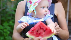 Six month baby girl with watermelon Stock Footage