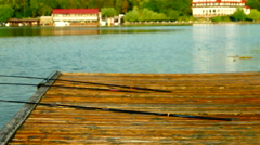 Stock Video Footage of Rods On Wooden Pier, Pan