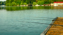 Rods On Wooden Pier, Pan Stock Footage