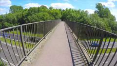POV Walking Foot Bridge Over Motorway Highway Traffic Road Trees Path Hand Held Stock Footage