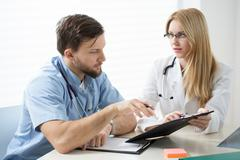Diagnosing the patient - stock photo